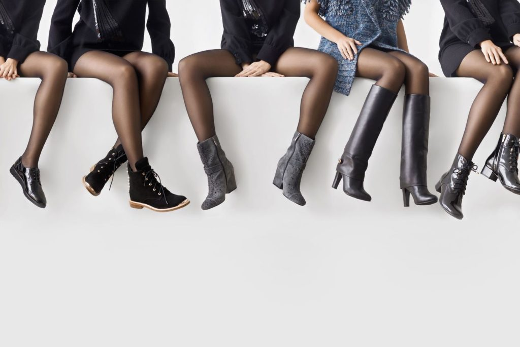 Women wearing boots in various styles and shapes.