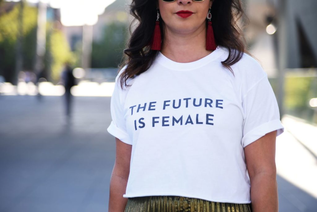 Woman with a statement t-shirt promoting the future being female