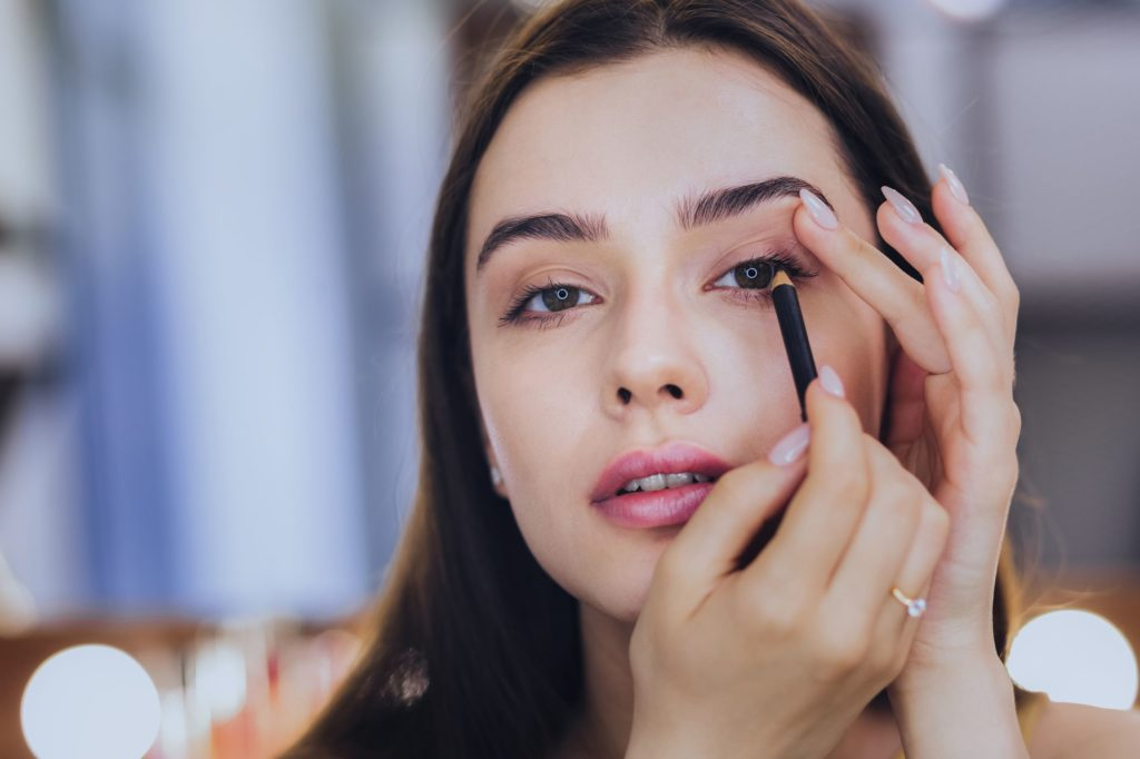 Classic winged liner for her makeup routine
